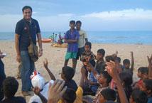 Akshay Madhavan with kids from the Slum Soccer programme